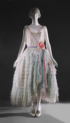 I love this one-- it's a classic, ethereal robe de style in a beautiful pastel color palette c.1927