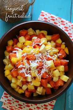 Tropical Fruit Salad Recipe. This tropical fruit salad, made with fresh papaya, mango, pineapple, bananas and grated coconut is the best tasting fruit salad... EVER!! ☀CQ #summer #salad #dressing