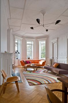 Love the parquet floor, use of colour and contrast of modern soft furnishings with trad moulding on ceiling.