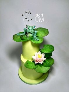B-day cake for small boy with funny frog. Everythings on cake is handpainted and leaves and flower are from wafer paper. Enjoy it.