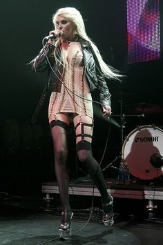taylor momsen in a great outfit during a concert.