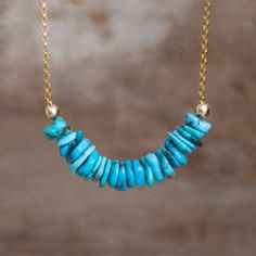 This necklace is so pretty! Even if I say so myself! All natural, genuine Arizona Turquoise beads have a gorgeous bright sleeping beauty colour mixed with some lighter hues and matrix. Hand cut, rustic rondelle beads have been strung together in a row creating a gorgeous texture that makes you want to reach. They have been set seamlessly in the centre of a 14K Gold Fill rolo chain. Also available in 925 Sterling Silver.  •Simple yet beautiful-Dainty yet impactful!  •Genuine Arizona Turquoise…