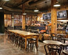 Located at the gateway to Seattle's historic Pike Place Market, this LEED Gold certified Starbucks evokes the warm heritage of our first store. The signage on the bar uses recycled slate from a local high school, the community table is twice reused, and a wall tapestry in the back is made of repurposed burlap coffee bags from our local roasting plant. starbuck, pike place, travel, coffee places, place market
