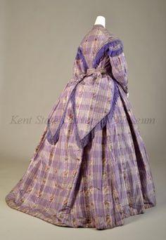 1860's Dress, Lavender & white plaid taffeta w/vertical rows of flowers, purple ribbon & fringe trimming.