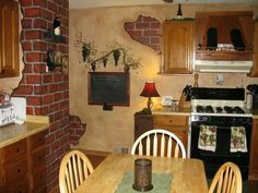 """""""Dirtied"""" up the walls and painted faux bricks for a """"wine themed"""" kitchen."""