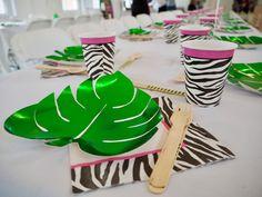 Safari themed table ay Yellow Zebra Safari's Family Day https://bit.ly/2KkAC4m