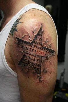 Unusual tattoo of a star on man's supper arm - Star tattoos