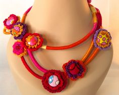 Off-Centre. A collier-style necklace of crocheted flowers, buttons and beads.