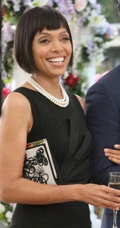 Camille's black folded detail dress and white embroidered clutch at Bones's wedding.  Outfit Details: http://wornontv.net/20976/ #Bones