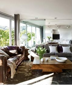 Love this wood coffee table, cocoa brown rug, and white walls.