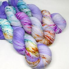 Each speckled skein is one of a kind! Spun Right Round's Superwash Sock 80/20 blends luxurious superwash merino wool with durable nylon for a yarn that's tough enough for socks yet soft enough for nex