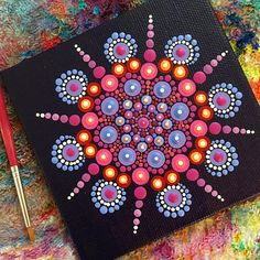 This original painting is sure to bring a little color into your home. Hand painted one dot at a time, this piece is lovingly crafted using vibrant, high quality acrylic paints. Each painting in signed Katie in beautiful Hindu script. Canvas is approximately 4 x 4 a a little less