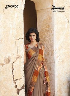 Carry on the Ultimate Fashion with Alluring Burlywood Georgette Saree which sets you out to be unique of all, further refined by multicolur Graphic Printed Lace added silver smoky effect. It is having burlywood silk Blouse.