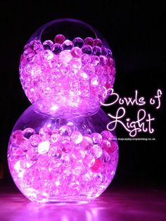 Bowls of Light - using aqua gel beads + submersible LED lights. This is such a simple to do decoration, but the effects are awesome! Great for weddings, parties or just for the holidays. There are lots of different coloured beads and lights available, you could match them to your theme!