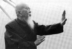 """Ba Gua Zhang instructor Li Zi ming - of Beijing, China, holds the """"Millstone"""" posture. This is the basic circle walking arm position. Helio Gracie, Tao Te Ching, Chinese Martial Arts, Warrior Spirit, Hapkido, Qi Gong, Taoism, Contemporary Photographers, Beijing China"""