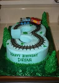Replace train tracks with road & add Mater & Lighting McQueen for monkeys cake.