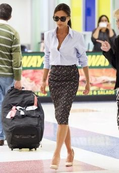 Victoria Beckham. feminine pencil skirt paired with a men's striped shirt. this woman defines polished.