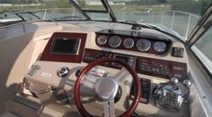 Sea Ray 370 Sundancer: The helm is attractive and functional with the wheel matching the burl wood panel.