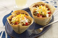 Mini Taco Bowls. Put soft tortillas in muffin tins, bake until hardened, and then add your toppings!