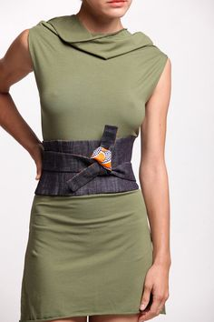 Inspired by the Japanese obi and tailored for perfect fit.    This belt is reversible and can be worn either on the funky printed side or the more