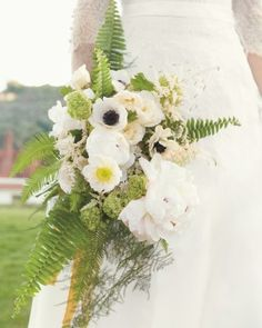 """Classic Cascade Bride Meaghan envisioned a """"Downton Abbey-ish"""" bouquet. The resulting mix of peonies, poppies, astilbes, and anemones wrapped in ferns was so gorgeous that she took it with her on her honeymoon."""