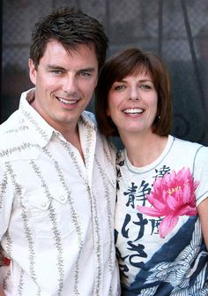 "John Barrowman Photos - Author Carole Barrowman and actor John Barrowman pose for a portrait at a book signing for John and Carole Barrowman's new book ""Anything Goes"" at Book Soup on July 23, 2008 in Los Angeles, California. - John Barrowman Portrait Session And Book Signing At Book Soup"