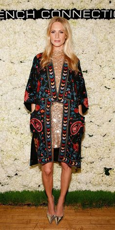 Poppy Delevingne looks party perfect in a printed kimono, sequined dress, and metallic heels