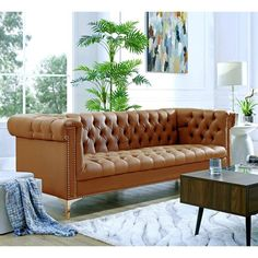 Our PU leather sofa adds a gentle sophistication in the confines of your living room, bedroom or entryway. Featuring scroll arm, rich PU leather upholstery, luxury button tufting and modern Y-shaped legs. This elegant accent piece provides both funct Tufted Couch, Tufted Leather Sofa, Sofa Upholstery, Suede Couch, Tan Sofa, Leather Couches, Sectional Sofa, Brown Sofa Design, Chesterfield Style Sofa