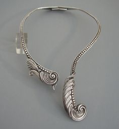 |  MARGOT de Taxco Mexico. sterling hinged wrap-around feather scrolls necklace. By Margot Van Voorhies Carr, a 1930's to 1970's jewelry maker.