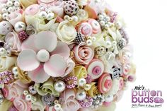 Cream, pink and ivory artificial roses, scattered with buttons, crystals and brooches are combined to create this beautiful vintage inspired Mixed Media Bouquet Brooch Bouquet