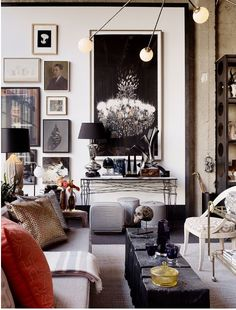 """Abigail Ahern's blog is inspirational - she uses this picture as an example of how to use lots of """"stuff"""" to dazzle the eye and draw it all over the room."""