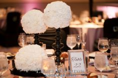 black and white centerpieces: white carnation balls on black candle sticks. Design by Avant Gardenia. #mscareergirl
