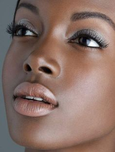 The charcoal and brown eye shadow paired with a neutral frosted lip look phenomenal on darker skin! I really love this look, especially the lip color, am curious to see how it would look on lighter skin such as mine. Oh and I must add, this models lips are insanely perfect! Gorgeous.