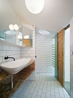 Contemporary bathroom by Edwards Moore. Oriented strand board and subway tiles combine for added character.