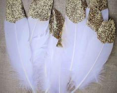 glitter dipped feathers! Beautiful, fun, boho décor idea! Wild One Feathers