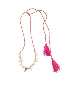 We love the surf-vibe of this baby shark tooth Mexican tassel necklace by Dezso