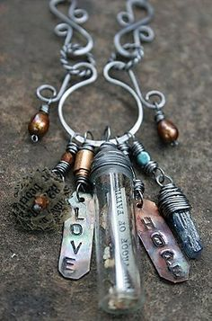 I'd LOVE a necklace thats kinda like this. its a charm necklace! :) add a old time watch, heart shaped metal locket, solid perfume holder, a bottle with a secret note inside and a skeleton key, this would be the PERFECT gift to me!!! :)