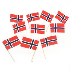 The Norwegian flag features a blue Scandinavian cross shifted to the hoist side, extending to the edges and outlined in white on a red background. American Flag Cake, Viking Decor, Viking Party, Norwegian Flag, Grandpa Birthday, Cocktail Garnish, National Flag, Red Background, Party Themes