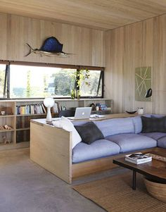 "Architect Cary Tamarkin calls the built-ins he designed ""elegant camp furniture."" They're all made of inch-thick fir plywood, including the living room's platform sofa. Design: Suzanne Shaker."