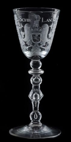 A Dutch engraved armorial light baluster goblet, mid 18th century, the round funnel bowl engraved with the arms of Schieland and inscribed SCHIELANT , on a baluster stem and conical foot, 18.5cm high