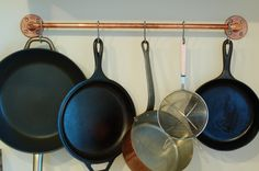 DIY copper pot rack: space saver!! love the warm tone of copper, & clean industrial look. (raiding hubby's pipe stash!)