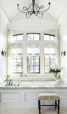 huge windows, the tub, the ceiling, & that light fixture!!