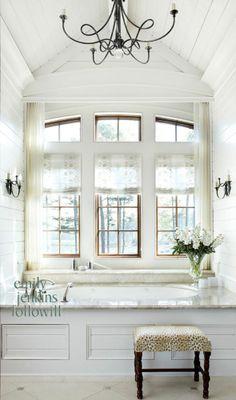 white paneling around bathtub