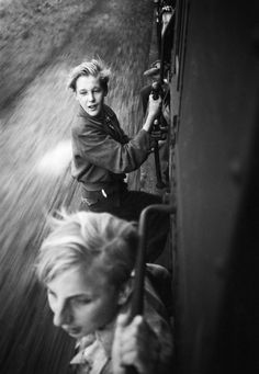 Menno Huizinga Children hanging on to a full train after the liberation. 1945
