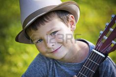music: cuacasian boy with guitar in the park outdoors