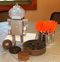 Table-bots - Each table had a wooden robot in the center that my daughter ordered from Etsy (spudbouy52). - Robot Birthday Party #robot #robotparty #centerpiece