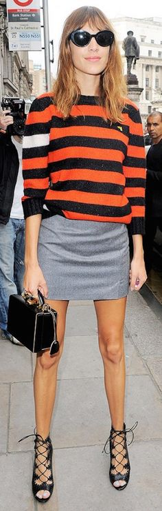 Alexa Chung in a striped blouse and leather skirt