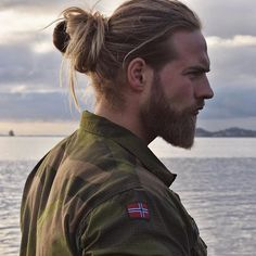Handsome Navy officer kicking it with man bun article on Mashable