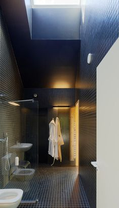 Bathroom at Villa Wallin by Swedish studio Erik Andersson Architects on an island in the Stockholm archipelago.
