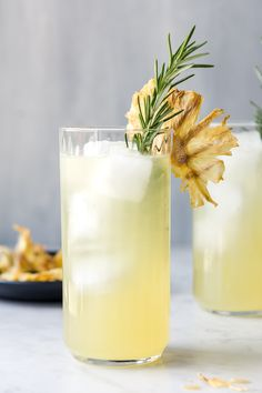 This pineapple fizz is layered with a touch of rosemary, soft white rum, and fresh lime juice. It's a refreshing pineapple rum cocktail perfect for summer!